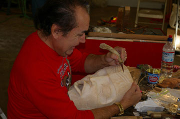 Tribal carver Joe Ives working on a mask.