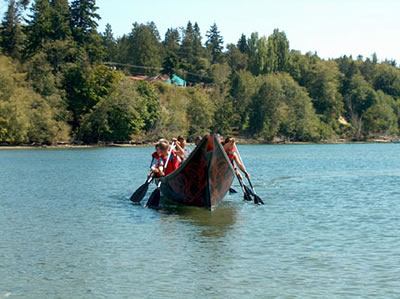 Young Tribal members practice paddling at Point Julia.