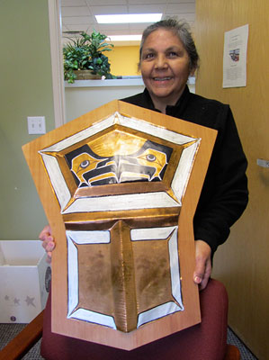Marie Hebert with copper shield, a gift to the Tribe from the Heiltsuk Nation on behalf  of Hereditary Chief Frank Brown.